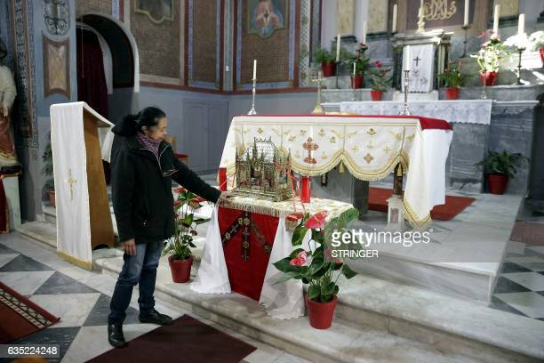 A woman touches the presumed relics of the Saint Valentine inside the Church of Metastasis of Virgin Mary in Mytilene on the island of Lesbos on...