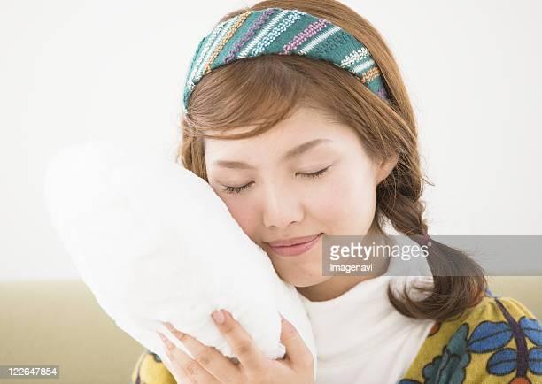 A woman touching cushion
