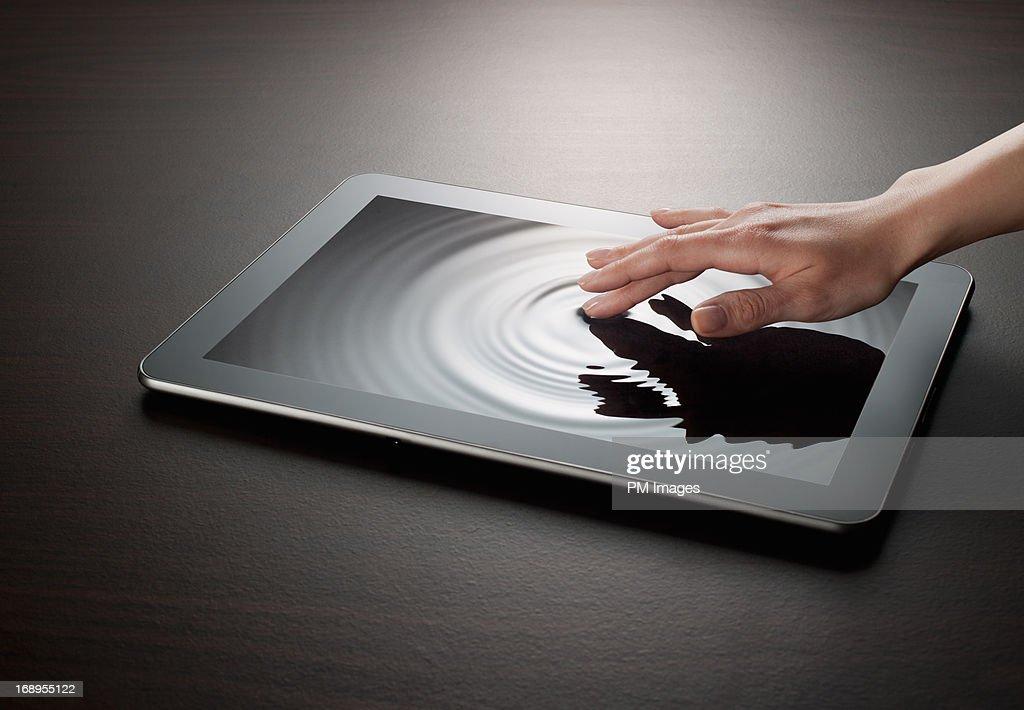 Woman touching digital water