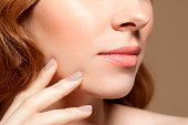 Woman touching face, close up