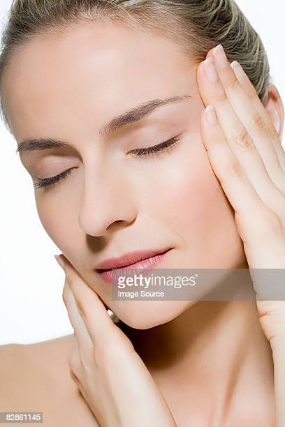 Woman touching face