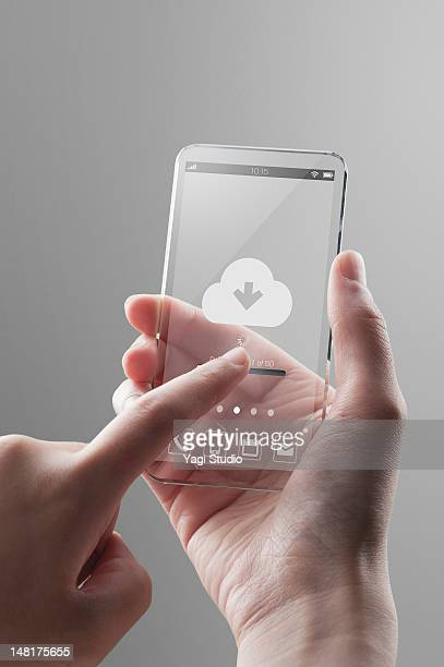 Woman touching  futuristic smartphone