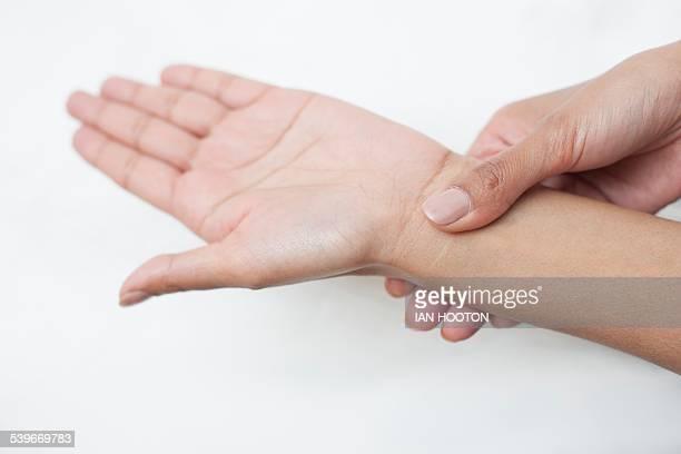 Woman touching her wrist