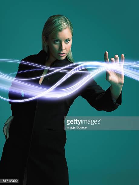 Woman touching light