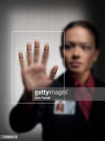 Woman touching security touching panel, close-up of hand