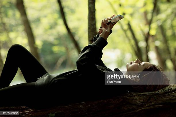 woman touching the mobile phones in the mountains