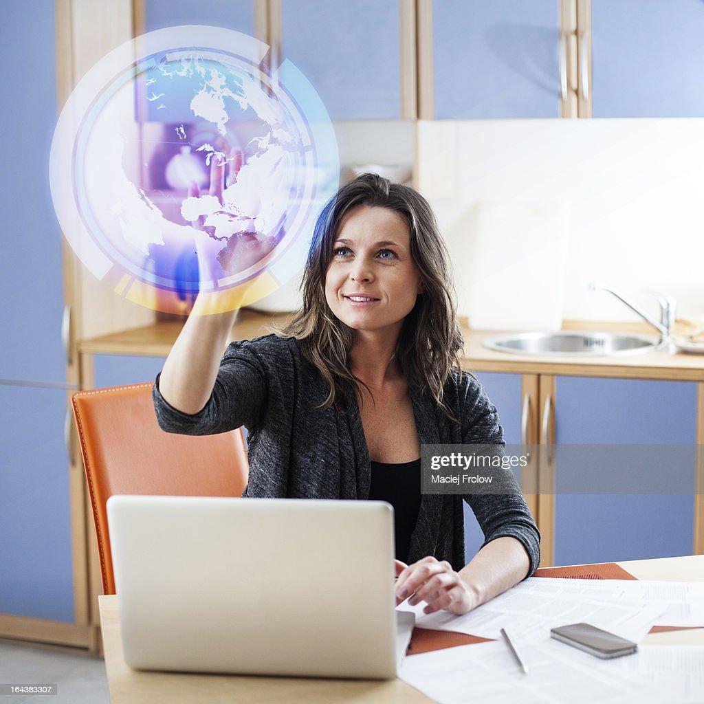 Woman touching virtual globe : Stock Photo