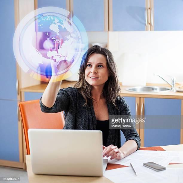 Woman touching virtual globe
