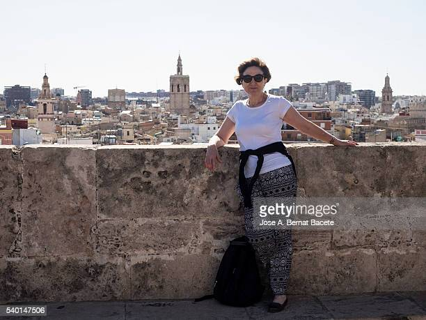 Woman tourist contemplating the city of Valencia from a high building