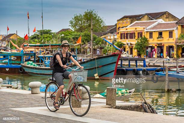 Woman Tourist Cycling in Hoi An City, Vietnam