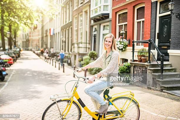 woman tourist cycling on amsterdam