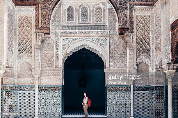 Woman tourist visiting old temple in Marrakech