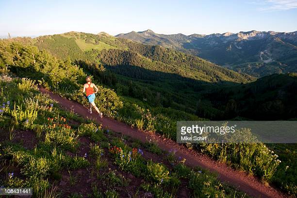 A woman  trail running on the crest trail. Big Cottonwood Canyon, Utah