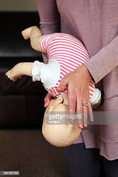 A woman trains to help a baby that is choking