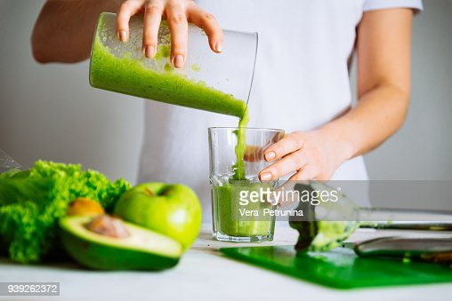 woman transfuse smoothie to glass. healthy food concept : Stock Photo