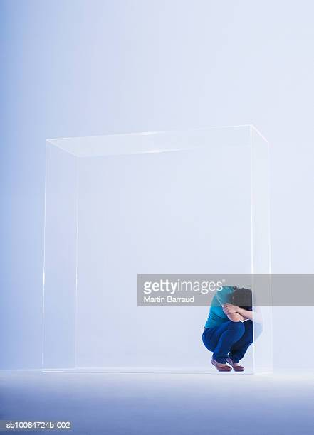 Woman trapped in glass cabinet
