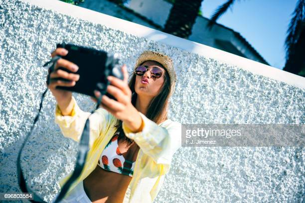 Woman traveler taking a selfie