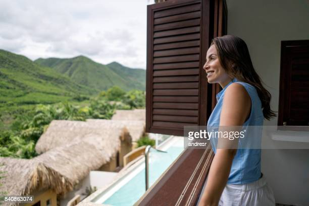 Woman traveling and looking at the view from her hotel