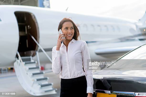 Woman traveling by plane and talking on the phone