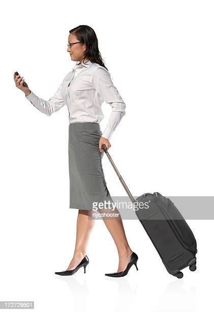 Woman traveling for business and checking a smart phone