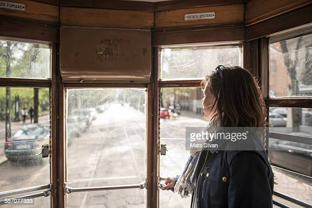 Woman traveling in a tram