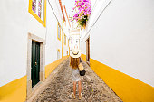 Young woman traveling on the street in the old town of Evora in Portugal