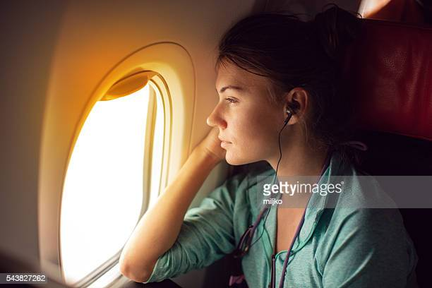 Woman traveling with plane and sitting by the window