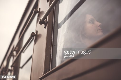 Woman travelling alone in a train : Stockfoto