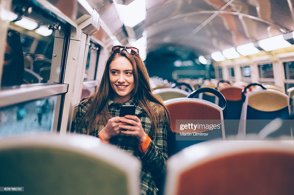 Woman travelling to work : Stock-Foto
