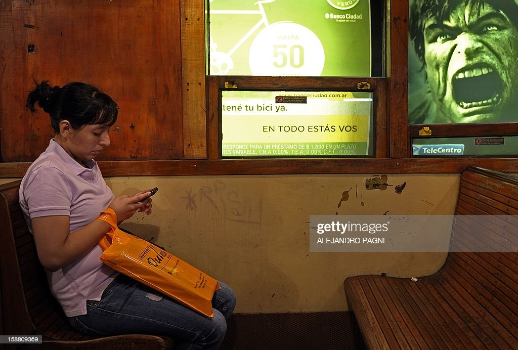 A woman travels in one of the historic wagons La Brugeoise on the subway Line A which is expected to be close soon following a decision by city mayor Mauricio Macri to replace the fleet with Chinese-made wagons, in Buenos Aires, on December 29, 2012. Line A was the first subway line to work in the southern hemisphere and its trains are among the ten oldest still working daily. The La Brugeoise wagons were constructed between 1912 and 1919 by La Brugeoise et Nicaise et Delcuve in Belgium.