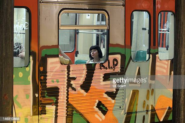 A woman travels on an underground train in the early morning of June 14 2012 in Athens Greece The Greek electorate are due to go to the polls in a...