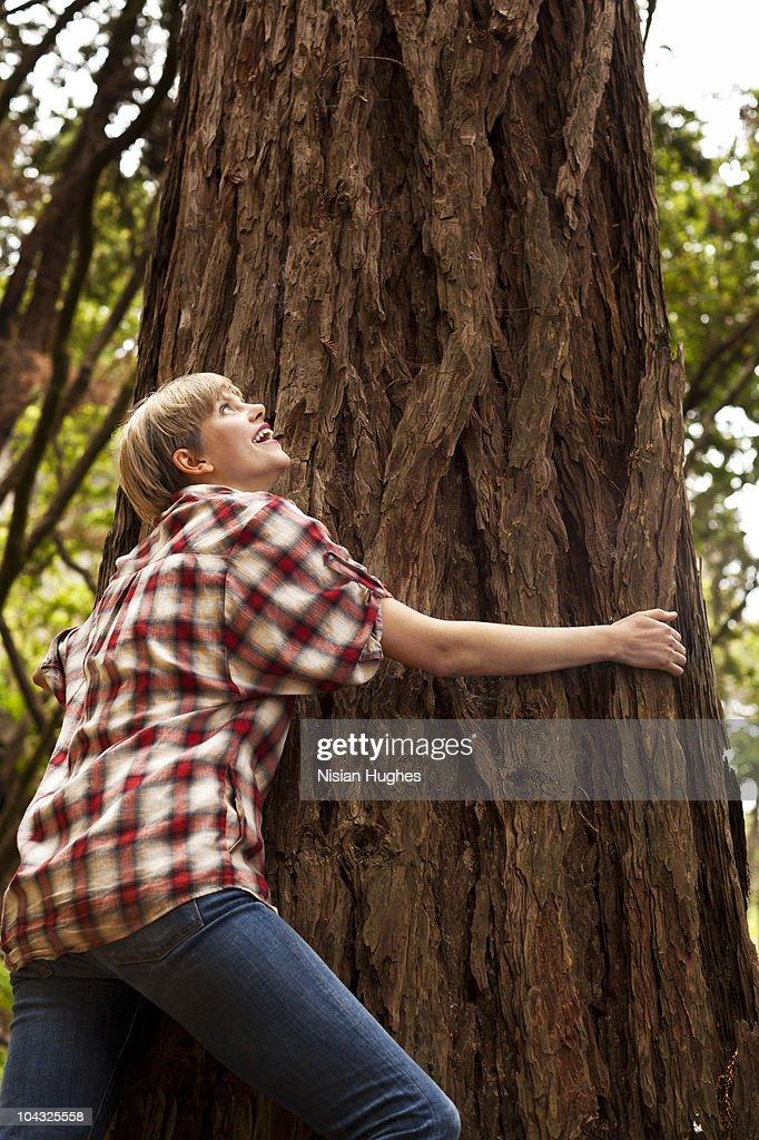 woman tree hugging : Stock Photo