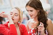 woman tries a perfume
