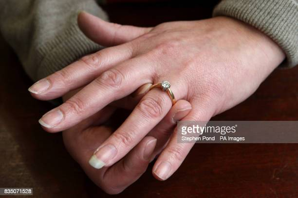 A woman tries on a diamond ring at a shop in the Jewellery Quarter Hockley Birmingham