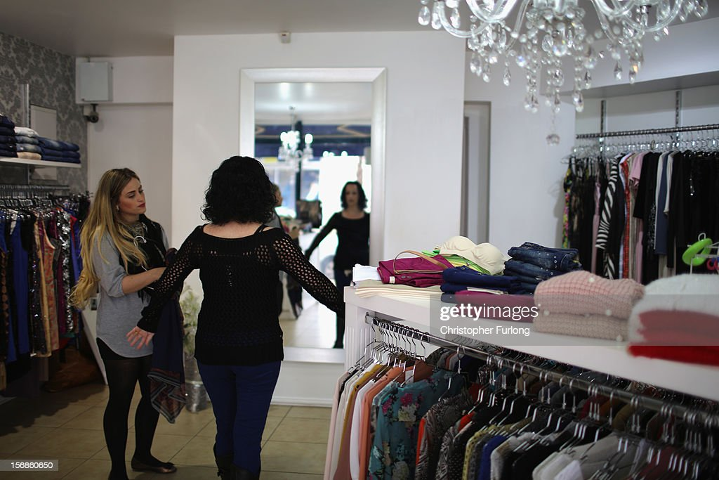 A woman tries on new clothes in a ladies fashion shop as businesses get back to normal in the Israeli border town of Sderot on November 23, 2012 in Sderot, Israel. Daily life in the southern border towns of Israel are returning to normal after eight days of rockets and alerts during the recent conflict between Israel and Hamas militants in the Gaza Strip.