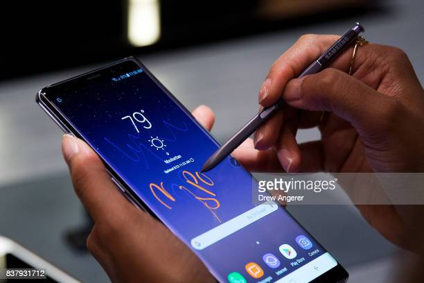 A woman tries the new Samsung Galaxy Note8 smartphone during a launch event August 23 2017 in New York City The Galaxy Note8 will be released in...