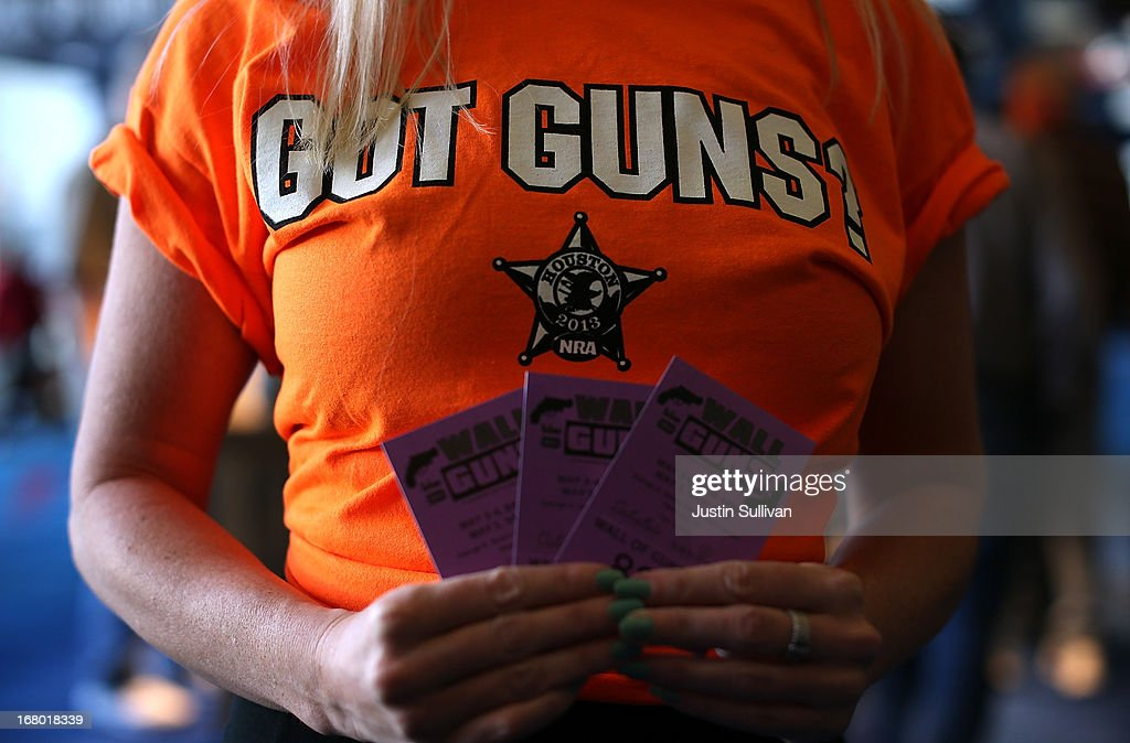 A woman tries to sell raffle tickets to win a gun from the 'Wall of Guns' during the 2013 NRA Annual Meeting and Exhibits at the George R. Brown Convention Center on May 4, 2013 in Houston, Texas. More than 70,000 peope are expected to attend the NRA's 3-day annual meeting that features nearly 550 exhibitors, gun trade show and a political rally. The Show runs from May 3-5.