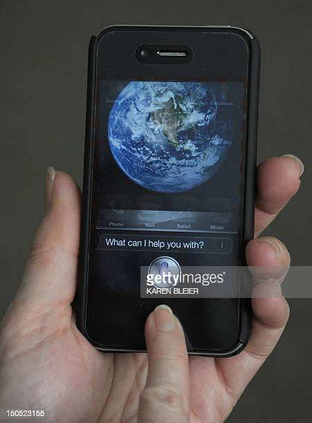 A woman tries to use 'Siri' voiceactivated assistant software built into the Apple iPhone 4S March 13 2012 in Washington DC An iPhone 4S buyer has...