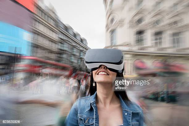 Woman trying a VR device in London