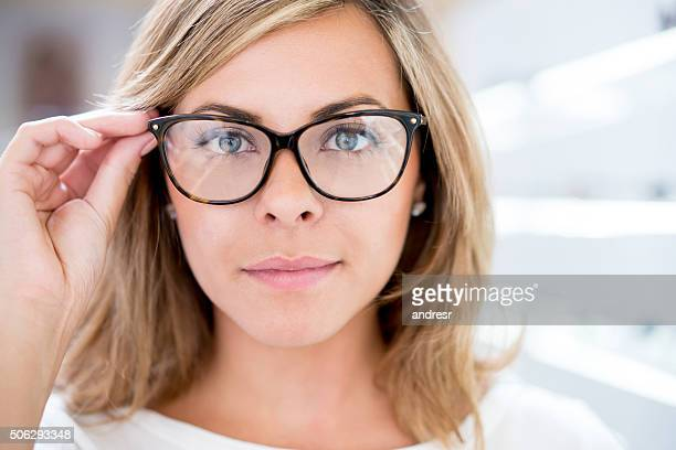 Woman trying glasses at the optics