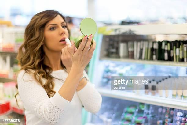 Woman trying lipstick