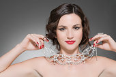 Woman trying on a diamond necklace