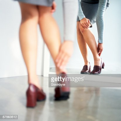 woman trying on a pair of shoes : Stock Photo