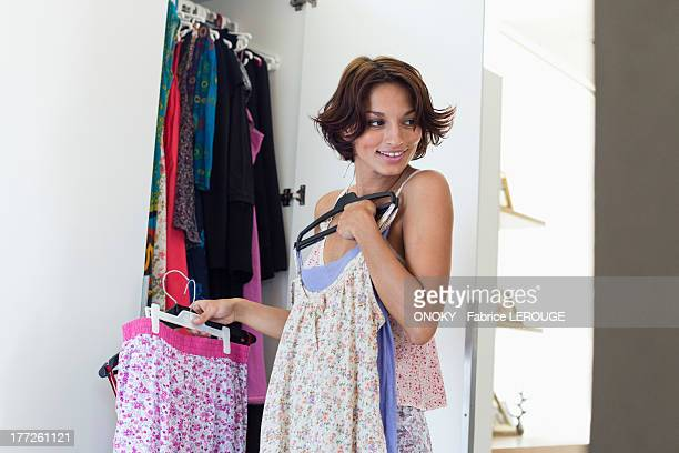 Woman trying on clothes at home