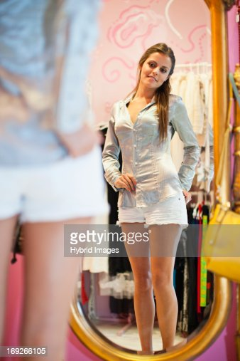 Woman trying on clothes in store