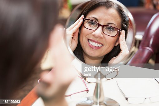 Woman trying on eyeglasses