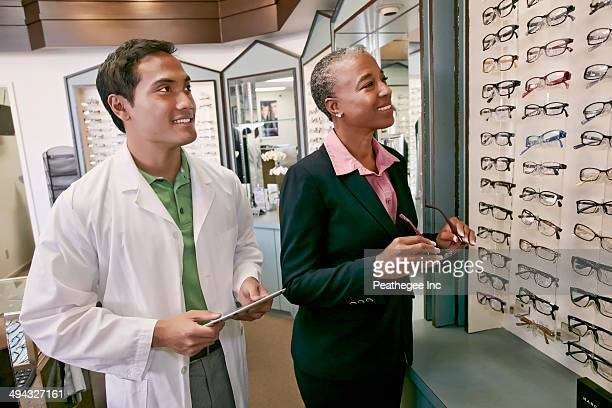 Woman trying on glasses at optometrist