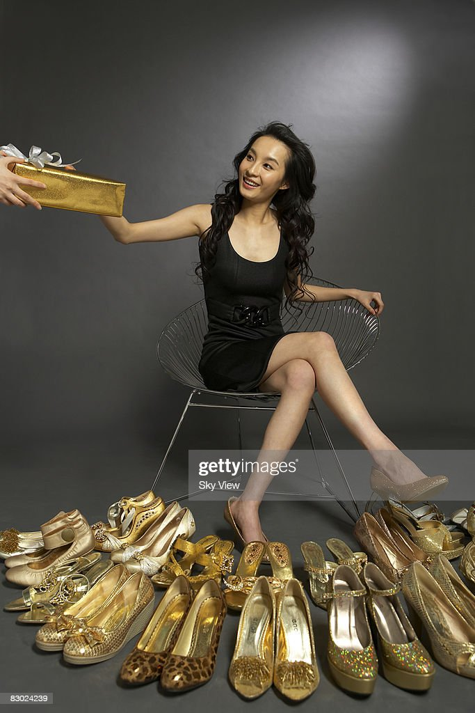 Woman trying on gold shoes