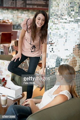 Woman trying on high heel shoe : Foto stock