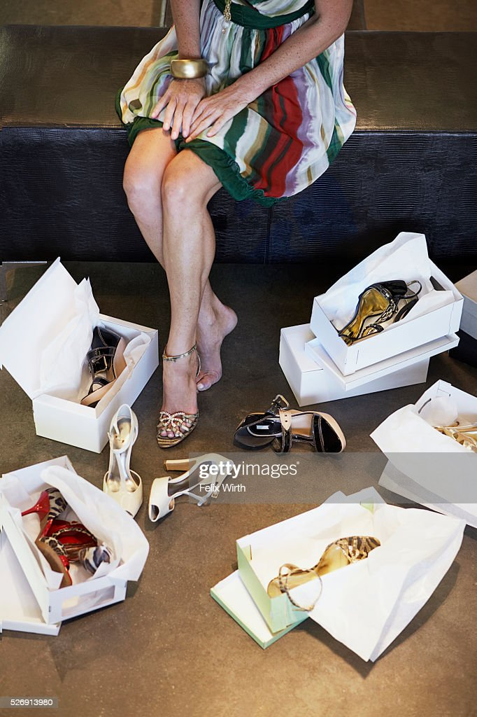 Woman trying on high heel shoes : Stock Photo